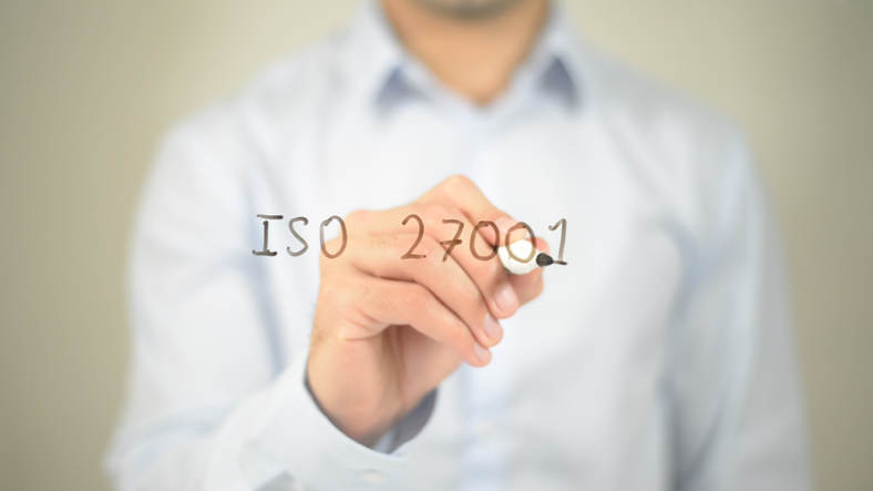 ISO 27001 , man writing on transparent screen